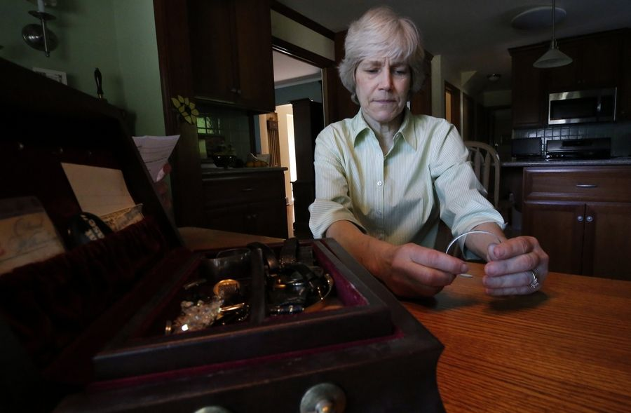In this jewelry box rests a metal bracelet that Barbara Van Slambrouck of Des Plaines wore in high school as a way to honor servicemen who were missing in action or prisoners of war in Vietnam.