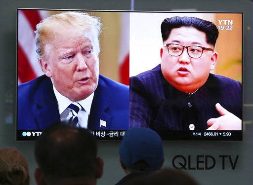 FILE - In this May 24, 2018, file photo, People watch a TV screen showing file footage of U.S. President Donald Trump, left, and North Korean leader Kim Jong Un during a news program at the Seoul Railway Station in Seoul, South Korea. Even if conciliatory rhetoric revives U.S.-North Korea summit plans, President Donald Trump and Kim Jong Un are still left with the gaping disconnect over what a deal on North Korea's nukes would look like. (AP Photo/Ahn Young-joon, File)