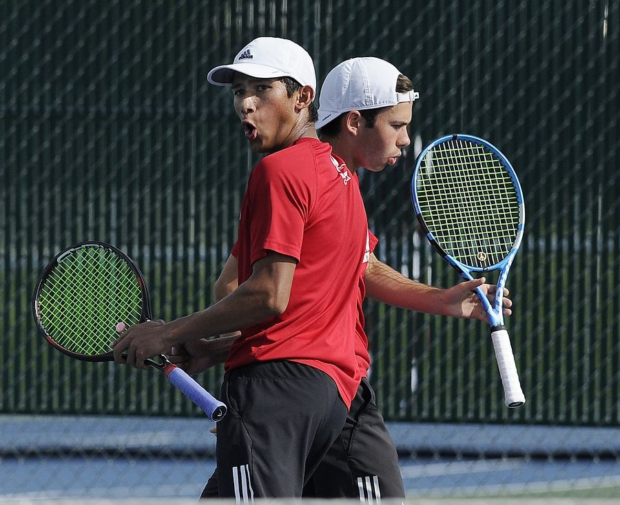 Naperville's Ammaar Saeed reacts with his tennis partner Martin Matov after scoring against Hinsdale Central in boys state tennis at Hersey High School on Saturday.