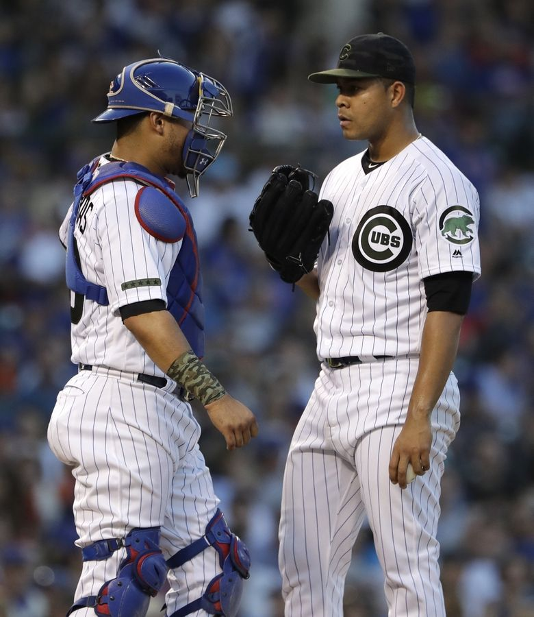 Chicago Cubs starting pitcher Jose Quintana, right, listens to catcher Willson Contreras during the fifth inning of a baseball game against the San Francisco Giants in Chicago, Saturday, May 26, 2018.