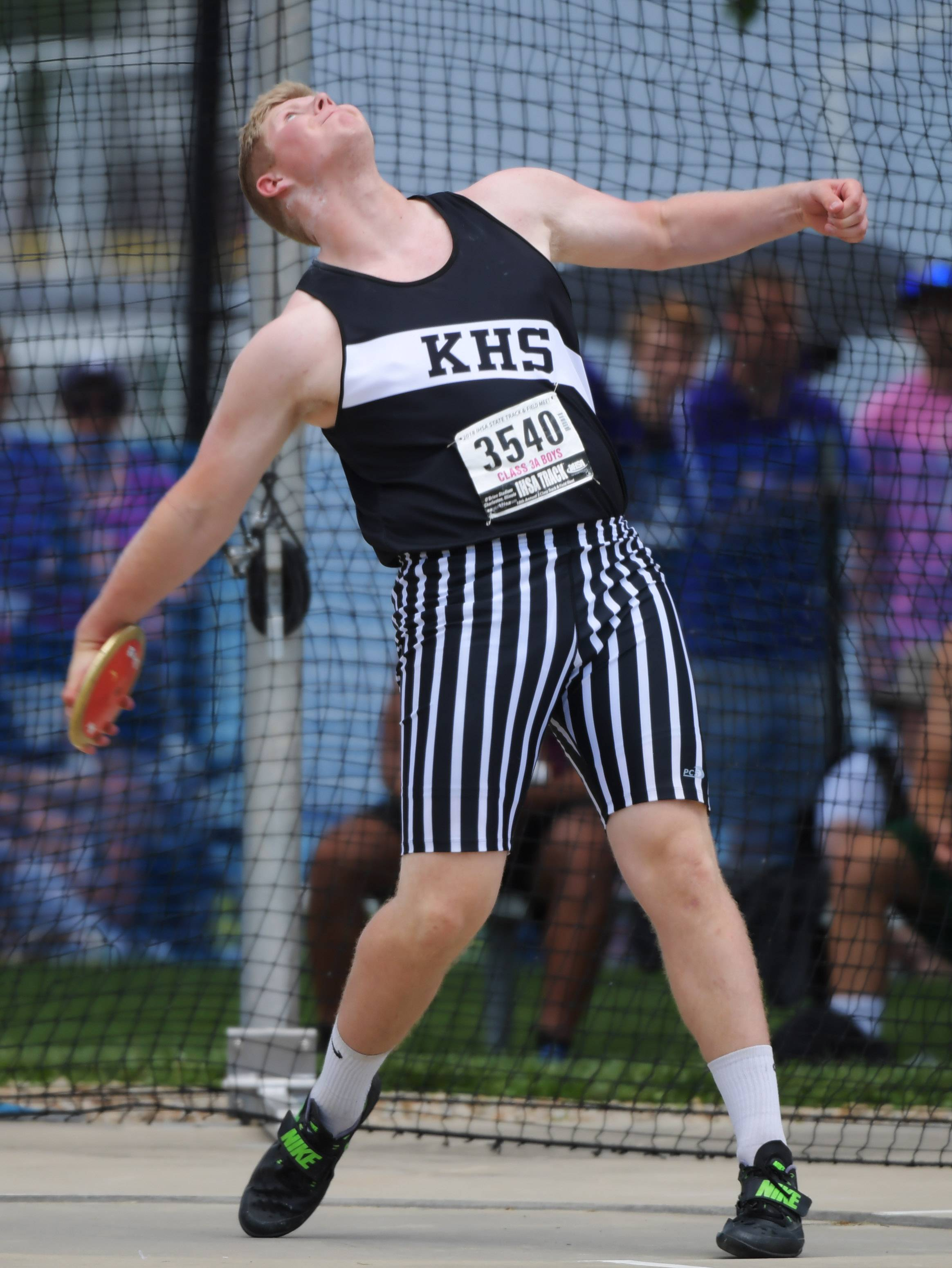 Kaneland's Clayton Hannula competes in the discus during the Class 3A boys state track and field finals in Charleston Saturday.