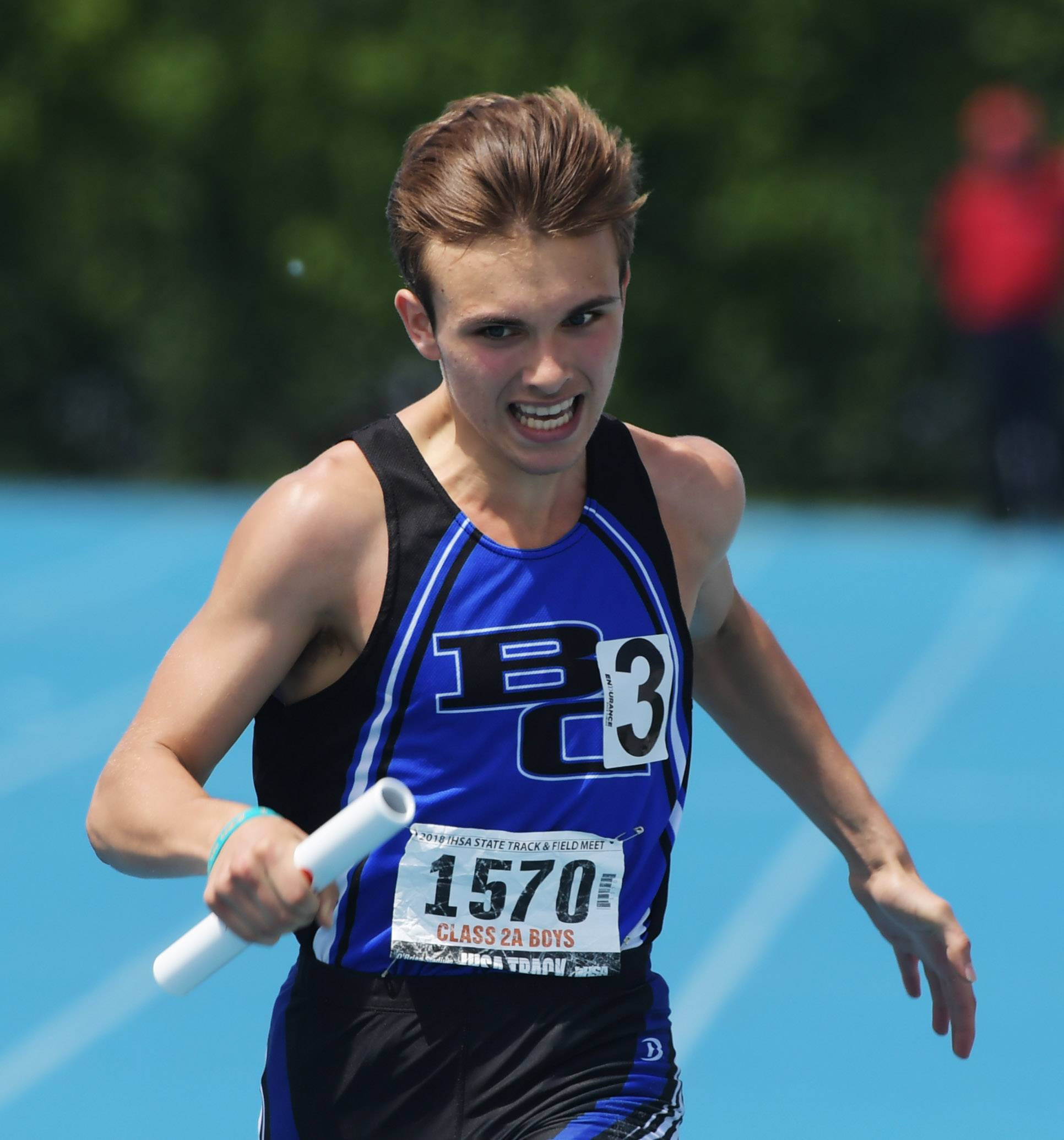 Burlington Central's Jacob Teets heads for the finish line in the 800-meter relay during the Class 2A boys state track and field finals in Charleston Saturday.