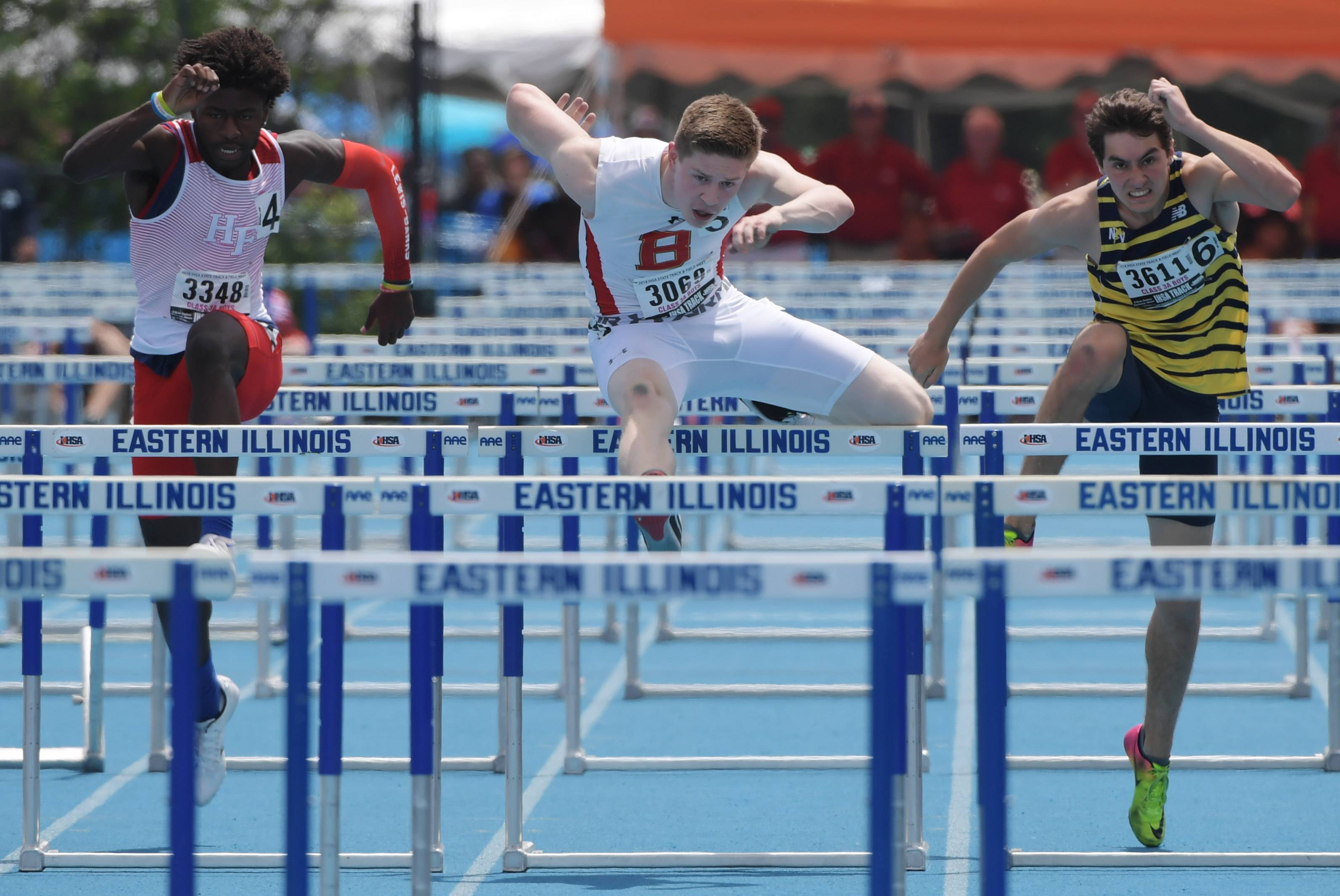 Batavia's Sam Conger, middle, and Neuqua Valley's Donovan Turner, right, head for the finish line in the 110-mewter high hurdles during the Class 3A boys state track and field finals in Charleston Saturday.