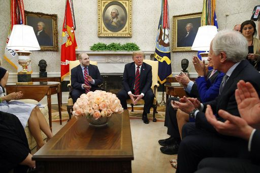 President Donald Trump, second from right, speaks as he sits with Joshua Holt, left who was recently released from a prison in Venezuela, with Sen. Bob Corker, R-Tenn., right, and others, in the Oval Office of the White House, Saturday, May 26, 2018, in Washington.
