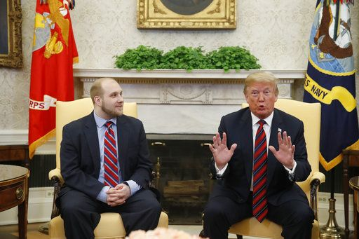 President Donald Trump, right, talks as Joshua Holt, who was recently released from a prison in Venezuela, joins him in the Oval Office of the White House, Saturday, May 26, 2018, in Washington.