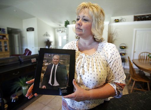 "FILE - In this July 13, 2016 file photo, Laurie Holt holds a photograph of her son Josh Holt at her home, in Riverton, Utah.  Josh Holt  has been released from a jail in Venezuela after spending nearly two years behind bars on weapons charges.  Utah Sen. Orrin Hatch said on Twitter Saturday, May 26, 2018,  that Joshua Holt had been released. President Donald Trump tweeted that it was ""good news,� adding that Holt ""should be landing in D.C. this evening and be in the White House, with his family, at about 7:00 P.M.�"