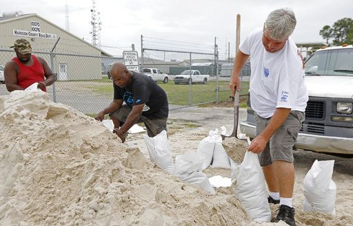 Gulfport, Miss., residents shovel sand into bags at a Harrison County Road Department sand bagging location, while preparing for Subtropical Storm Alberto to make its way through the Gulf of Mexico, Saturday, May 26, 2018. The slow moving storm is threatening to bring heavy rainfall, storm surges, high wind and flash flooding this holiday weekend.