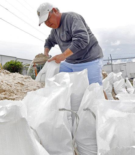 Eddy Warner loads sand bags as he waits for family members to assist and tie off and load the bags into his vehicle, while preparing for Subtropical Storm Alberto to make its way through the Gulf of Mexico in Gulfport, Miss., Saturday, May 26, 2018. Warner will use the bags as a barrier to keep water from flooding his garage. The slow moving storm is threatening to bring heavy rainfall, storm surges, high wind and flash flooding this holiday weekend.