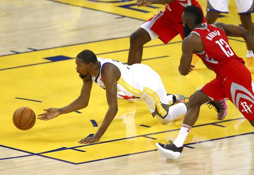 Golden State Warriors forward Kevin Durant, left, reaches for the ball in front of Houston Rockets guard James Harden (13) during the second half of Game 6 of the NBA basketball Western Conference Finals in Oakland, Calif., Saturday, May 26, 2018.