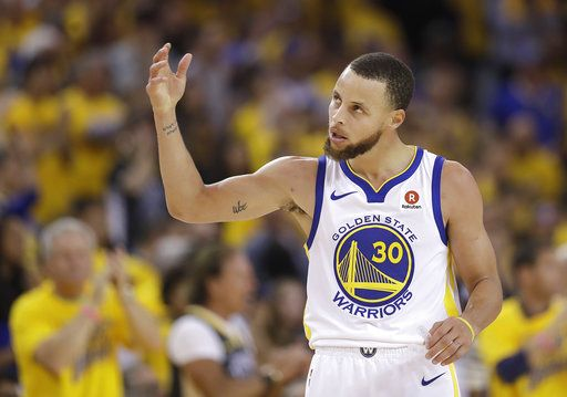Golden State Warriors guard Stephen Curry (30) gestures during the first half of Game 6 of the NBA basketball Western Conference Finals between the Warriors and the Houston Rockets in Oakland, Calif., Saturday, May 26, 2018.