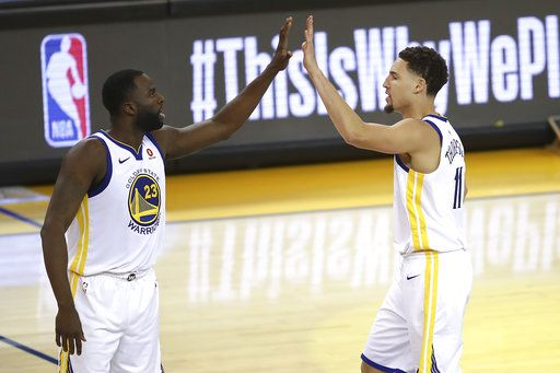 Golden State Warriors forward Draymond Green (23) celebrates with guard Klay Thompson during the second half of Game 6 of the NBA basketball Western Conference Finals against the Houston Rockets in Oakland, Calif., Saturday, May 26, 2018.