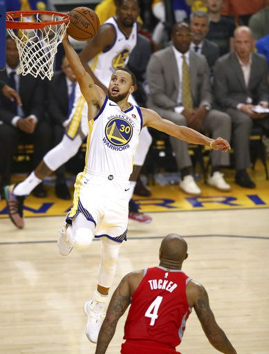 Golden State Warriors guard Stephen Curry (30) shoots against Houston Rockets forward P.J. Tucker (4) during the first half of Game 6 of the NBA basketball Western Conference Finals in Oakland, Calif., Saturday, May 26, 2018.