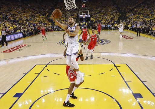 Golden State Warriors guard Stephen Curry shoots against the Houston Rockets during the first half of Game 6 of the NBA basketball Western Conference Finals in Oakland, Calif., Saturday, May 26, 2018.