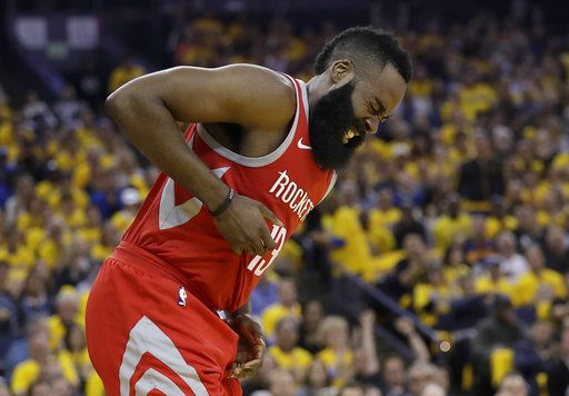 Houston Rockets guard James Harden (13) reacts during the first half of Game 6 of the NBA basketball Western Conference Finals between the Golden State Warriors and the Rockets in Oakland, Calif., Saturday, May 26, 2018.