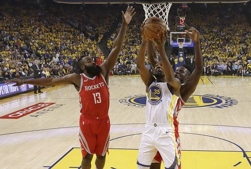 Golden State Warriors forward Kevin Durant (35) shoots against Houston Rockets guard James Harden (13) and center Clint Capela during the first half of Game 6 of the NBA basketball Western Conference Finals in Oakland, Calif., Saturday, May 26, 2018.