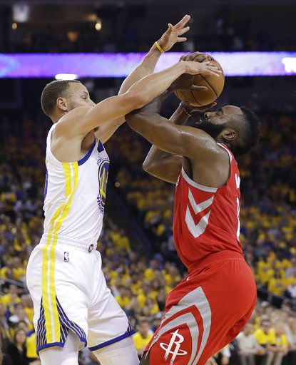 Houston Rockets guard James Harden, right, is defended by Golden State Warriors guard Stephen Curry during the first half of Game 6 of the NBA basketball Western Conference Finals in Oakland, Calif., Saturday, May 26, 2018.