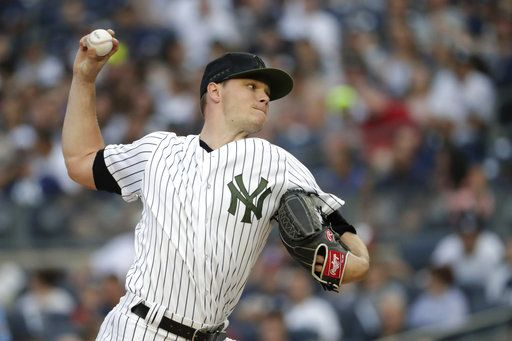 New York Yankees starting pitcher Sonny Gray throws to a Los Angeles Angels batter during the first inning of a baseball game Saturday, May 26, 2018, in New York.