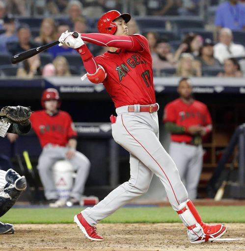 Los Angeles Angels' Shohei Ohtani strikes out against New York Yankees relief pitcher Jonathan Holder during the fifth inning of a baseball game Saturday, May 26, 2018, in New York.