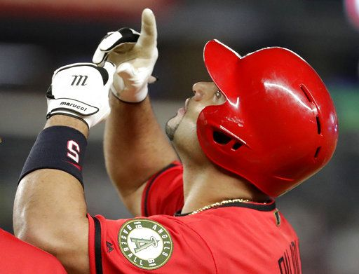 Los Angeles Angels' Albert Pujols gestures after a single off New York Yankees relief pitcher Tommy Kahnle during the sixth inning of a baseball game Saturday, May 26, 2018, in New York.