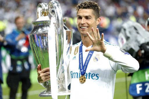 Real Madrid's Cristiano Ronaldo celebrates with the trophy after winning the Champions League Final soccer match between Real Madrid and Liverpool at the Olimpiyskiy Stadium in Kiev, Ukraine, Saturday, May 26, 2018.
