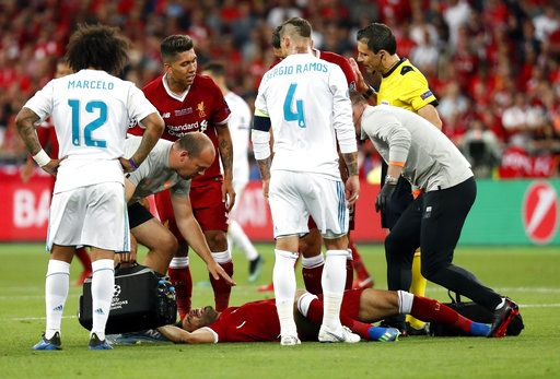 Liverpool's Mohamed Salah grimaces on the ground after injuring himself during the Champions League Final soccer match between Real Madrid and Liverpool at the Olimpiyskiy Stadium in Kiev, Ukraine, Saturday, May 26, 2018.