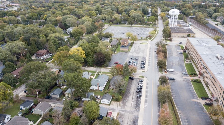 A developer working with the city of Naperville to plan new development along 5th Avenue near the Metra station could seek permission next month to begin designs of what could be built on 13 acres of city-owned property. The process excites some leaders and residents, while it concerns others.