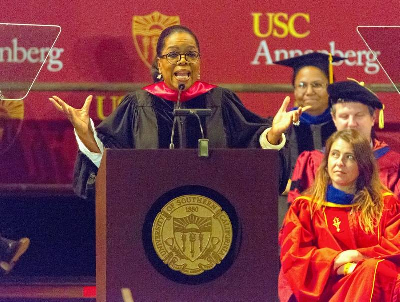 "Oprah Winfrey speaks to graduates at USC's Annenberg School for Communication and Journalism at the Shrine Auditorium in Los Angeles. ""The number one lesson I can offer you where your work is concerned,"" said the media titan, ""is this: Become so skilled, so vigilant, so flat-out fantastic at what you do, that your talent cannot be dismissed."""