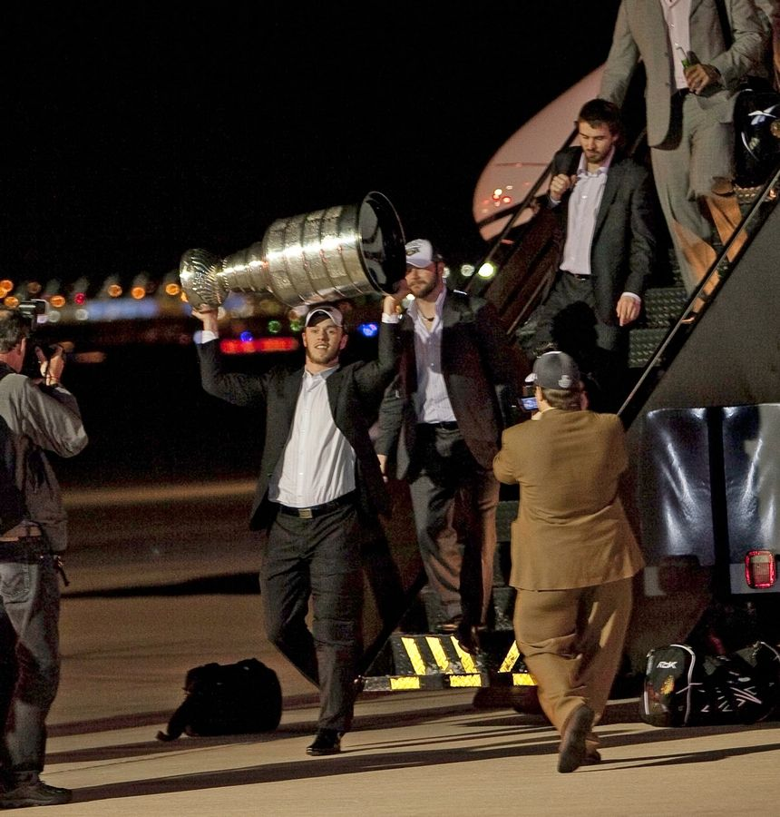 The Chicago Blackhawks' Jonathan Toews carries the Stanley Cup off the team plane after arriving at O'Hare International Airport June 10, 2010, from Philadelphia, where the team won the championship.