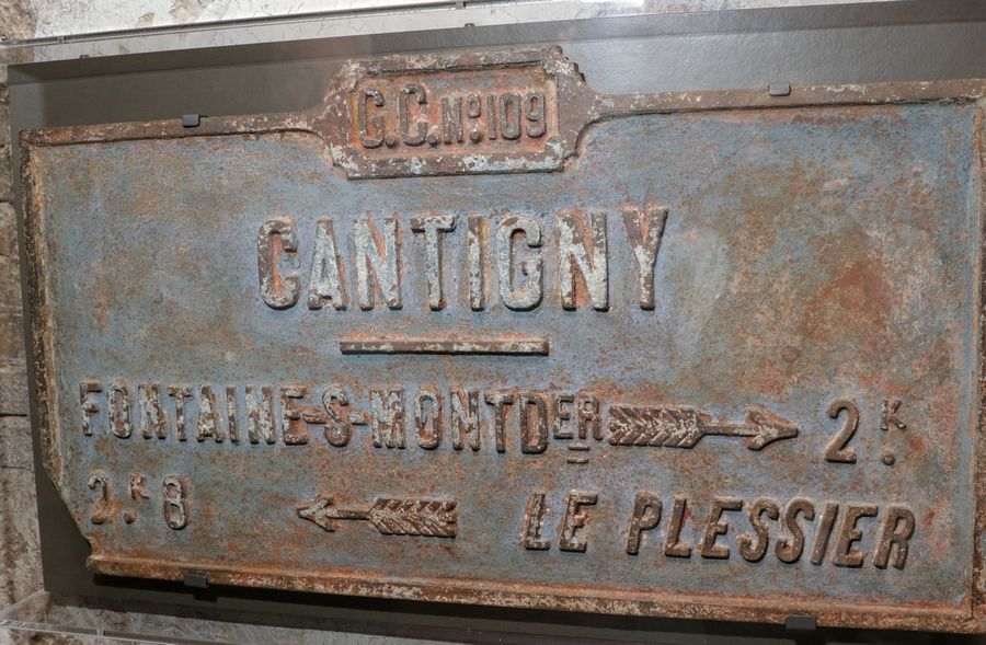 "A road sign from 1918 gives directions to Cantigny, a small village in France and the site of the first major American offensive in World War I. The sign is displayed in the ""First in War"" gallery at the First Division Museum at Cantigny Park in Wheaton."