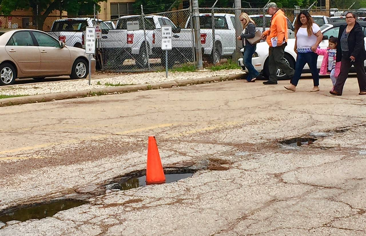 The driver's services facility in Elgin is pockmarked with potholes. A fix is coming, a spokesman for the Illinois secretary of state's office promises.