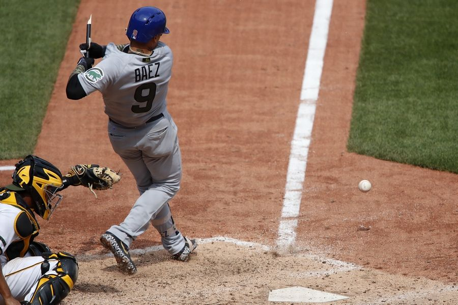 Chicago Cubs' Javier Baez (9) hits a broken-bat infield single off Pittsburgh Pirates relief pitcher Kyle Crick in the eighth inning in Pittsburgh, Monday.