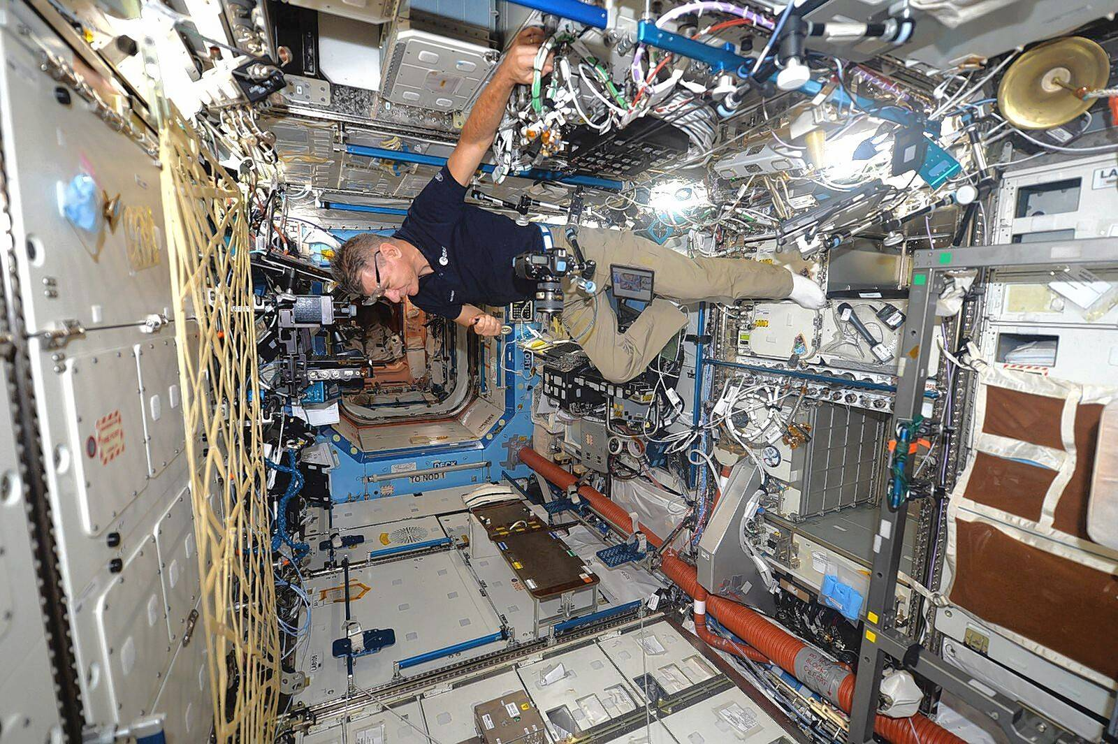 Italian astronaut Paolo Nespoli hovers photos during the shooting in zero gravity on board the International Space Station last year