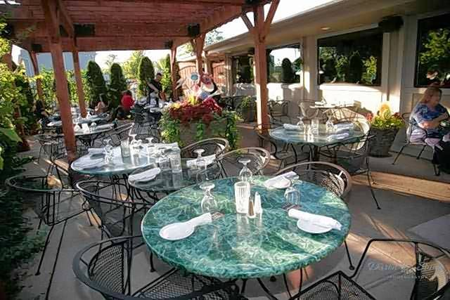 The outdoor patio at Adelle's in Wheaton includes a pergola and handcrafted decor.