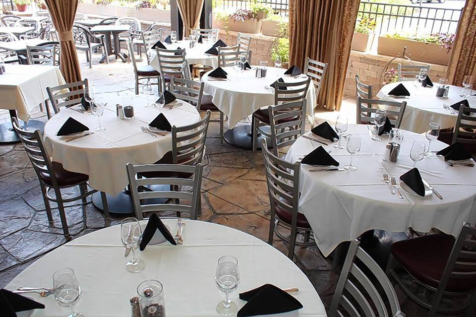 A covered outdoor patio at Agio Italian Bistro in Palatine allows patrons to enjoy the fresh air rain or shine.