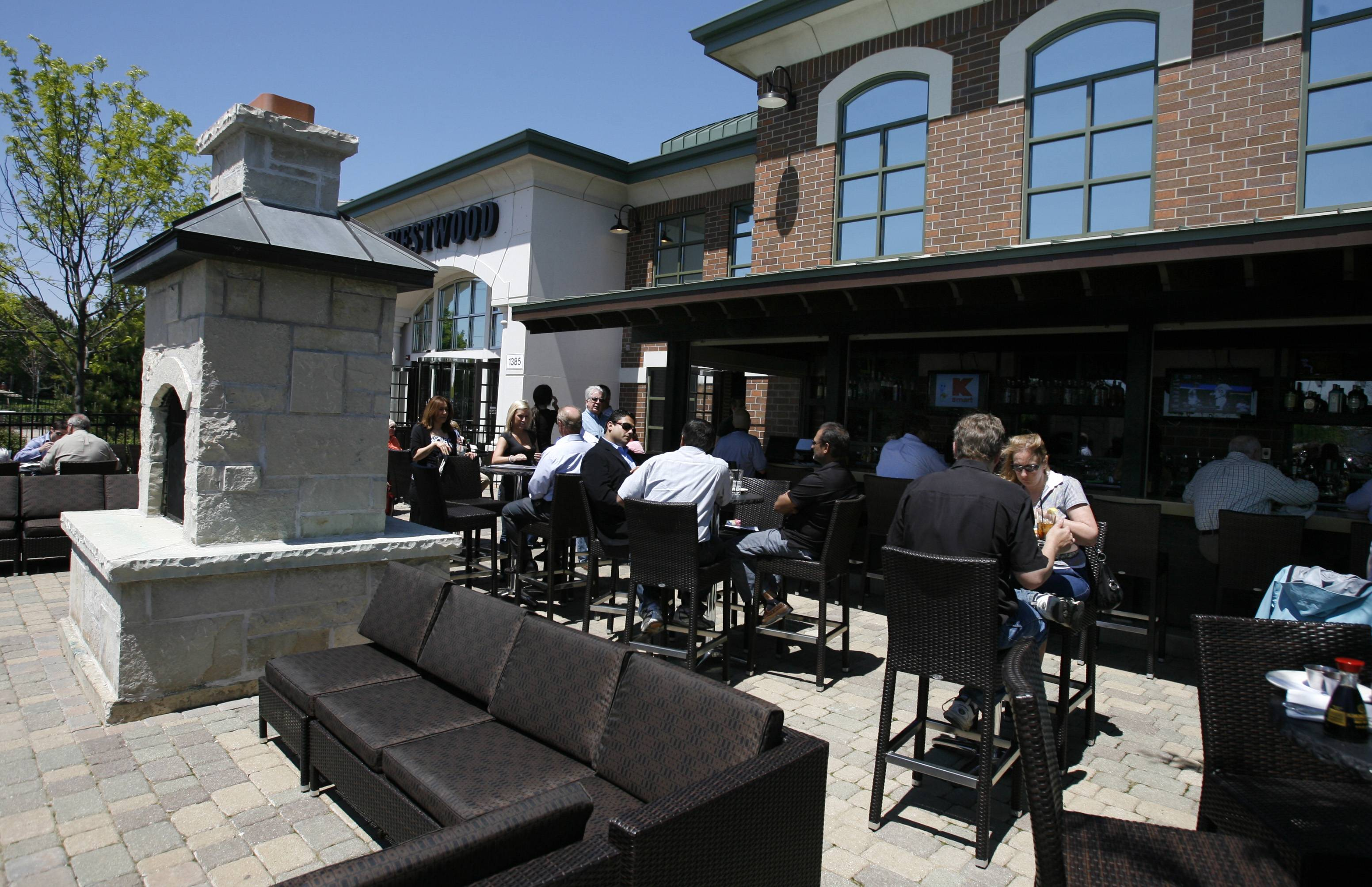 Fireplaces and lounge seating are included in the outdoor dining area of Westwood Tavern in Schaumburg.