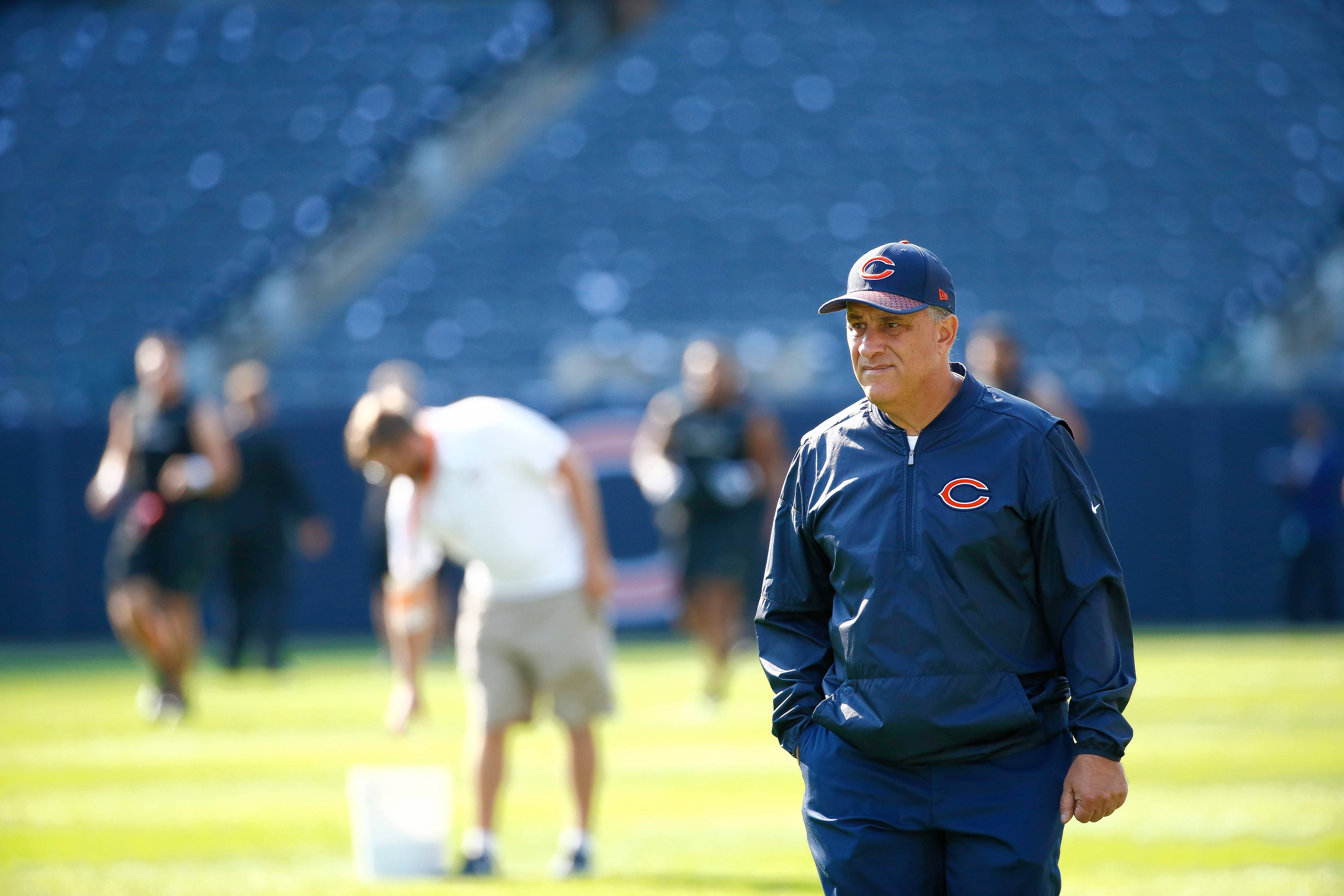 Chicago Bears defensive coordinator Vic Fangio walks on the field before an NFL football game against the Atlanta Falcons, Sunday, Sept. 10, 2017, in Chicago.