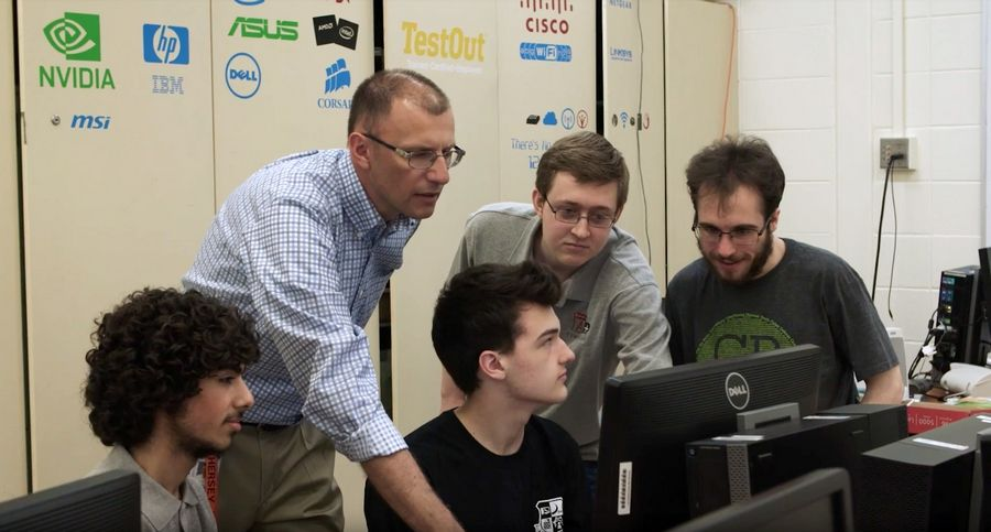 District 214 instructor Tom Polak works with students at Hersey High School who are pursuing cybersecurity careers. Many of his students have earned certifications from CompTIA, a nonprofit trade association that issues professional certifications for the information technology industry.