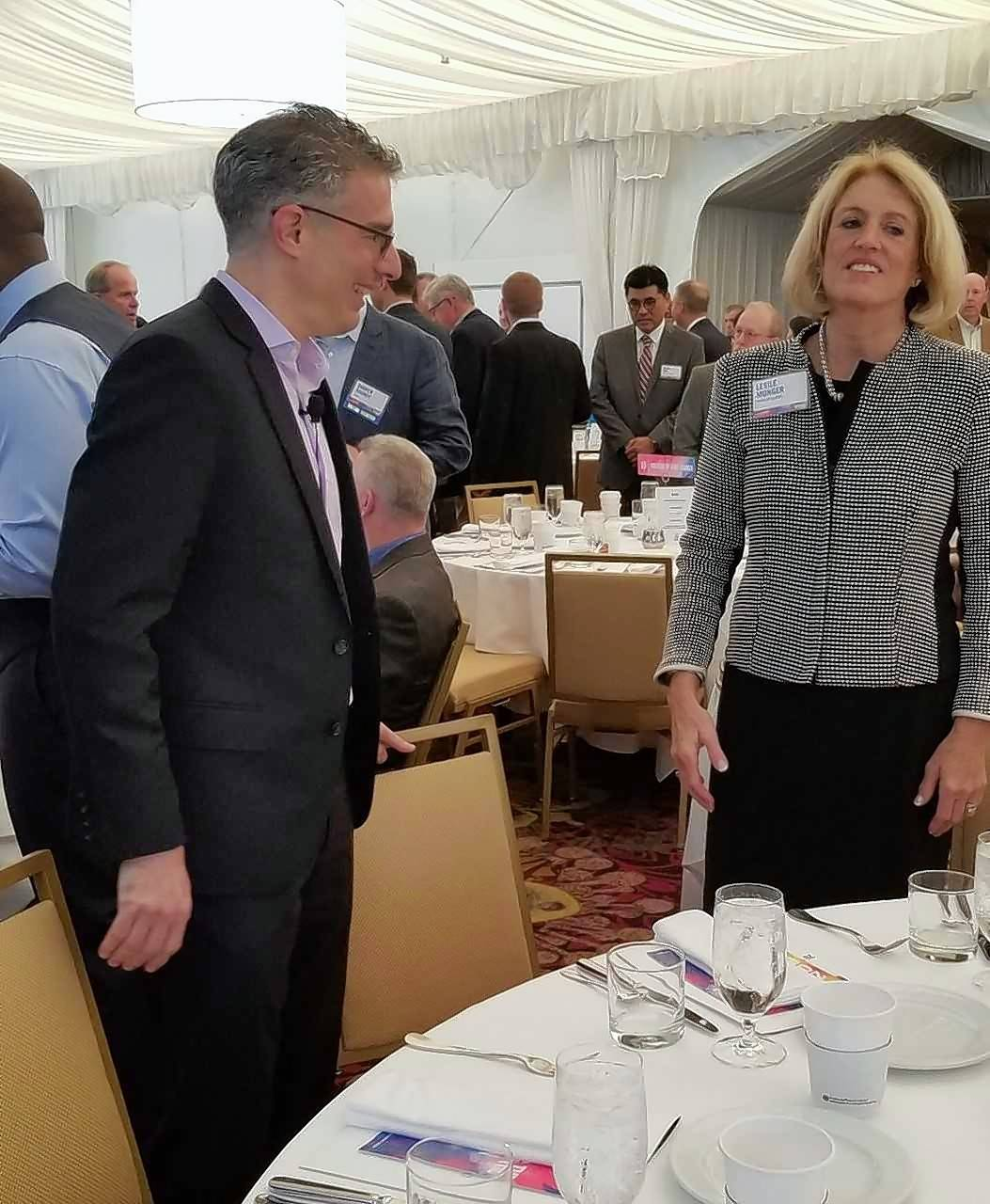 Keynote speaker Robert Safian talks with former state comptroller Leslie Munger before the Lake County Partners economic event Friday in Lincolnshire.