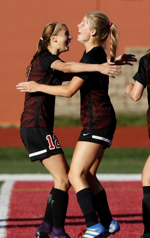 Barrington's Michayla Herr, right, celebrates with Ashley Prell (12) after Herr's decisive goal in a 1-0 win over Naperville North during the Class 3A girls state soccer semifinals at North Central College on Friday.