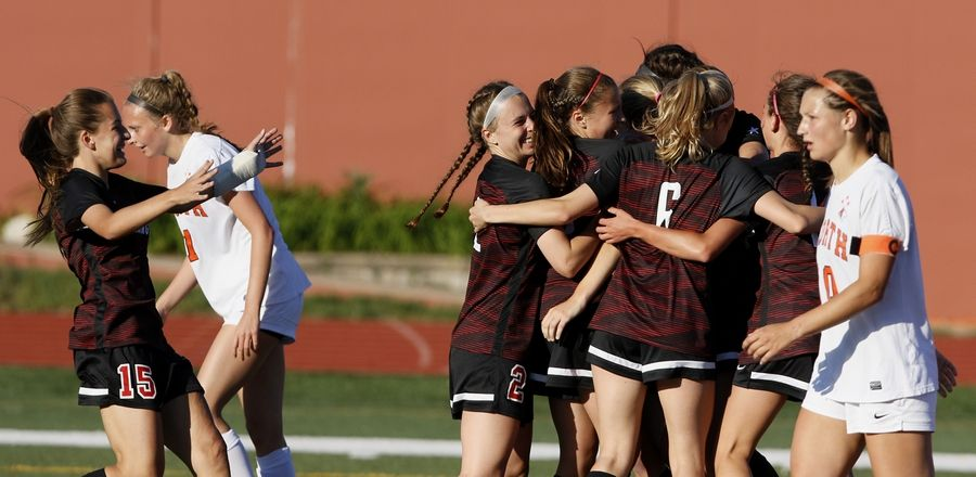 Barrington players celebrate scoring in a 1-0 win over Naperville North during the Class 3A girls state soccer semifinals at North Central College on Friday.