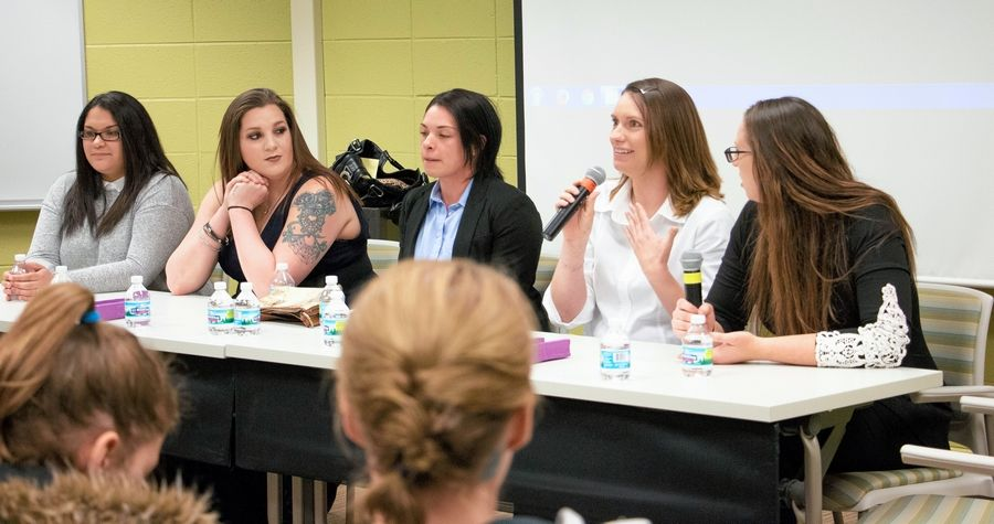 Whitney Morgan of Woodstock shares experiences from her Army service. She joined four other McHenry County College student veterans on a panel during Women's History Month in March 2017. Panelists from left are: Gladys Clark of McHenry, Air Force; Jessica Gasaway of McHenry, Army; Ericka Schork of Huntley, Marine Corps; Morgan; and Carrie Dinovo of Lake Barrington, Marine Corps Reserves.