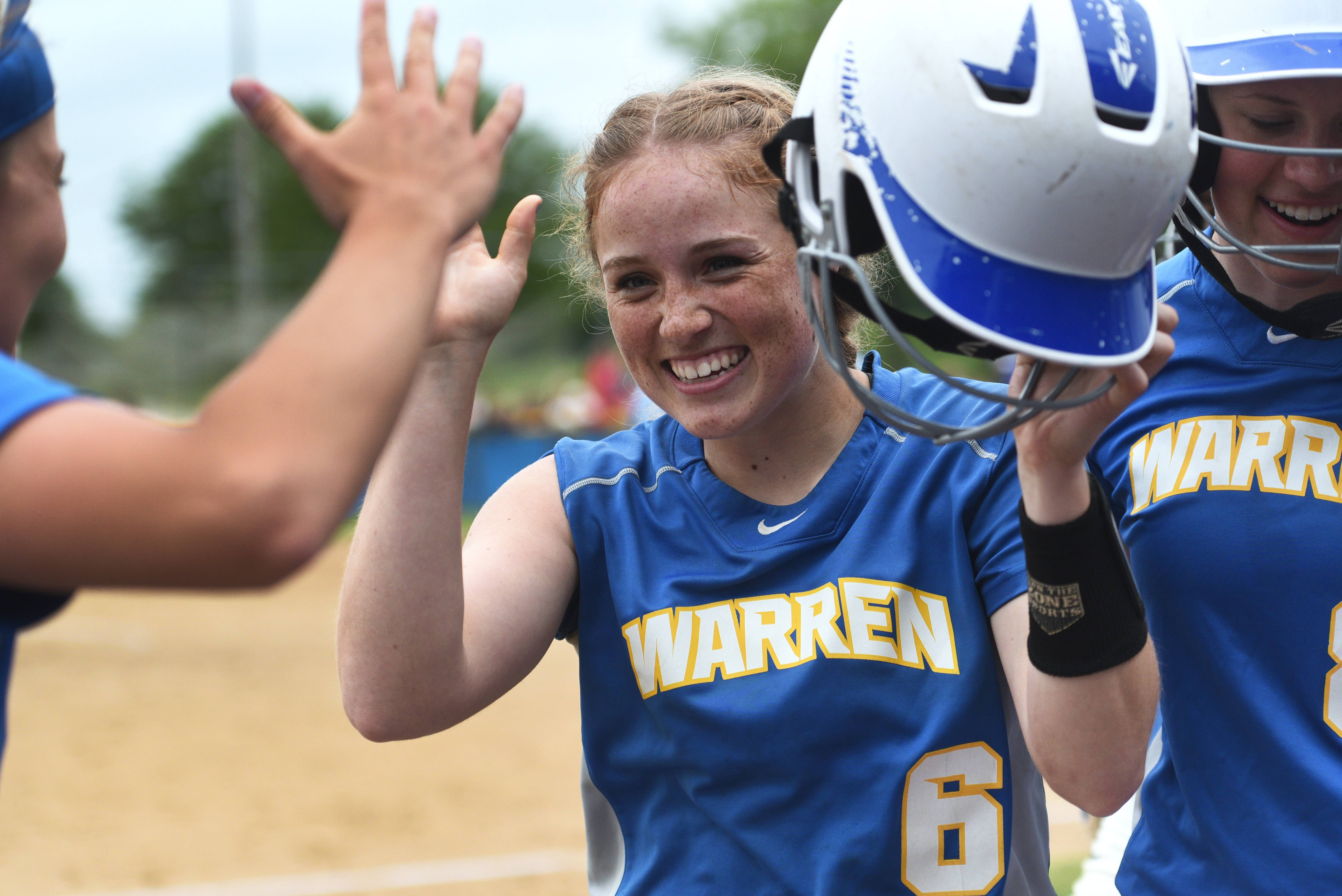 Warren's Ashlyn Kitter (6) is congratulated for her third-inning home run against Palatine during the Class 4A girls softball sectional championship in Gurnee.