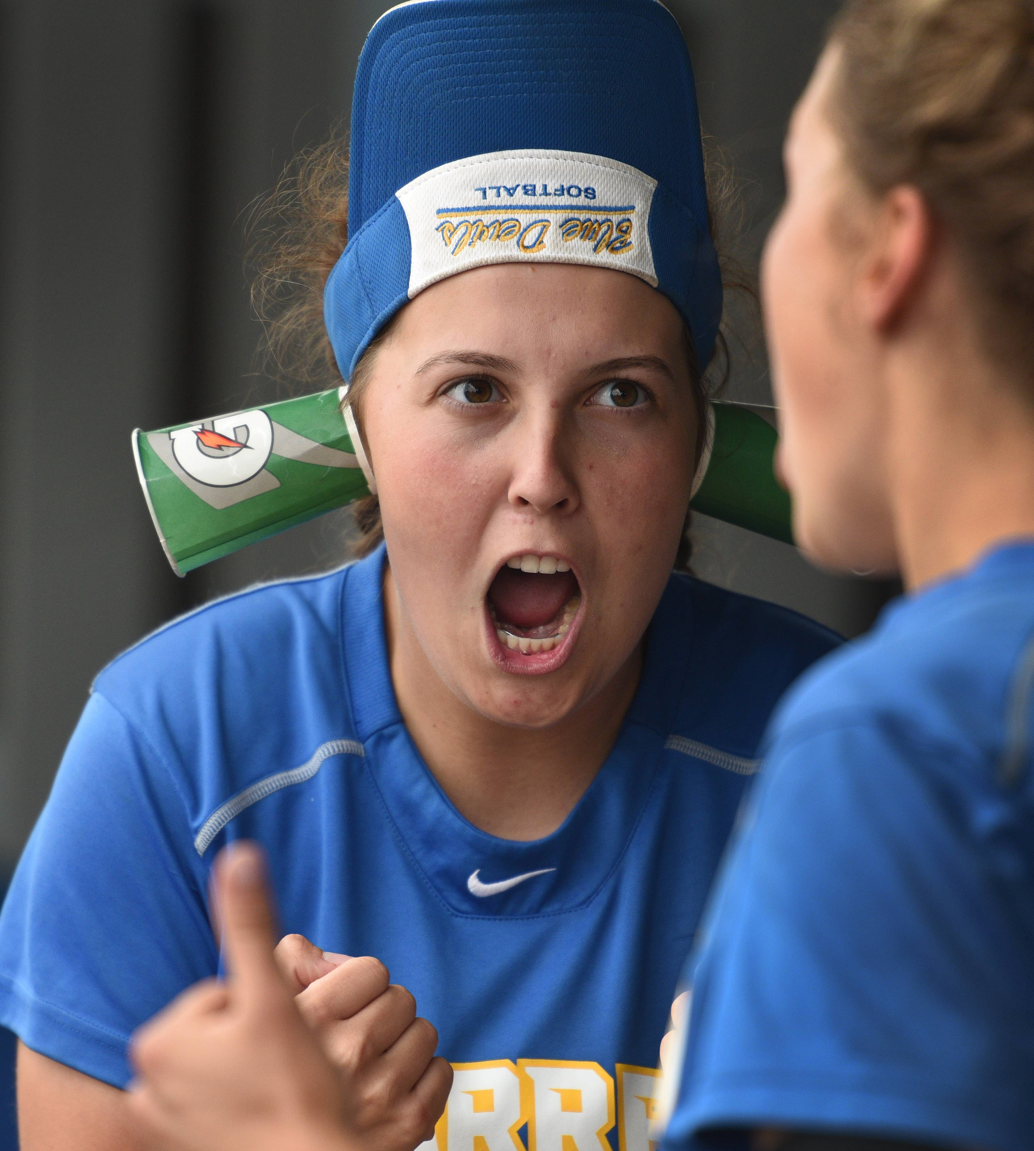 Warren's Kelly Beck keeps the enthusiasm level high in the dugout with her rally cups and visor during Saturday's Class 4A girls softball sectional championship game against Palatine on Saturday in Gurnee.