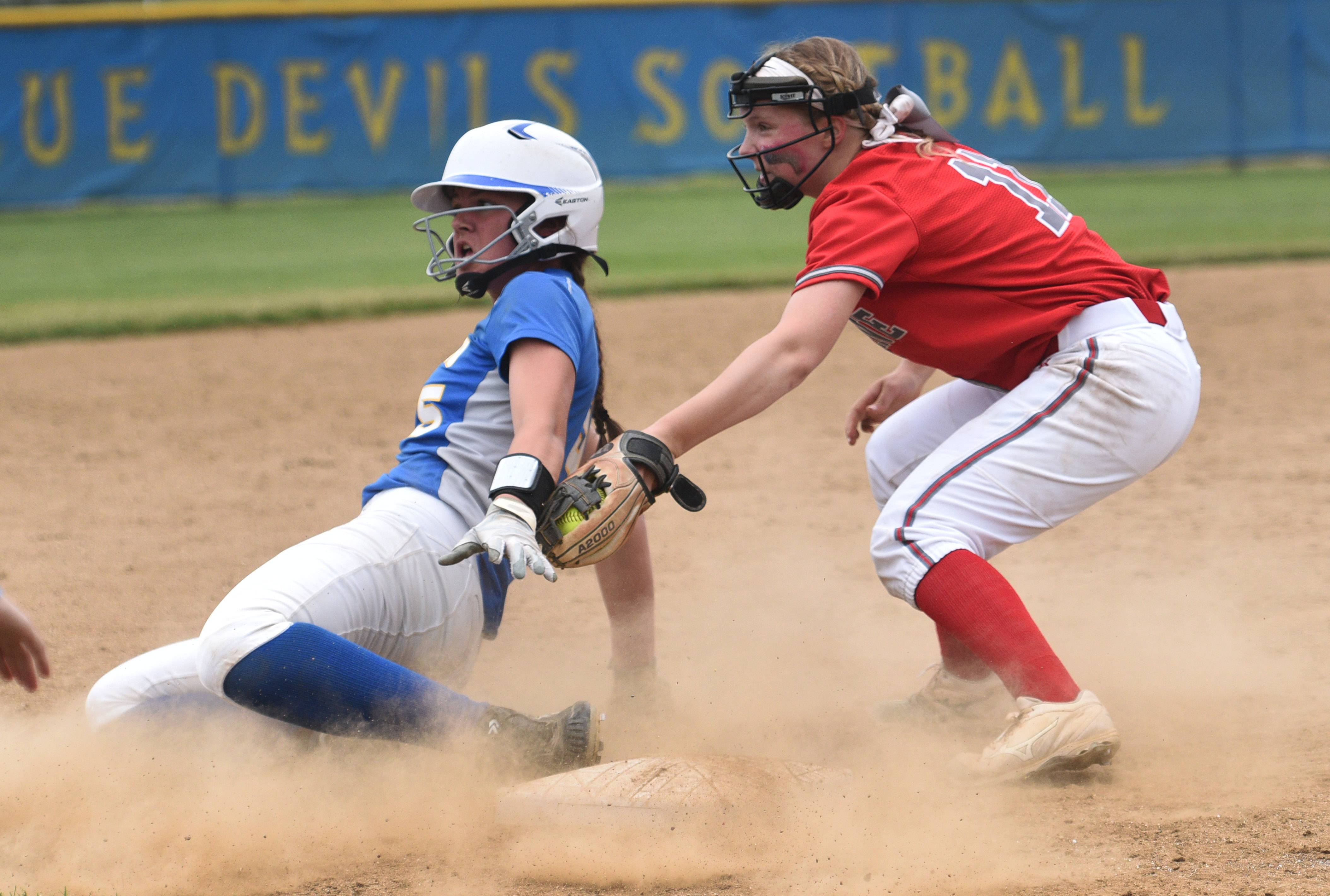 Palatine's Maddie Craver, right, applies the tag to Warren's Allison Schiltz during Saturday's Class 4A girls softball sectional championship in Gurnee. Schiltz was called out.