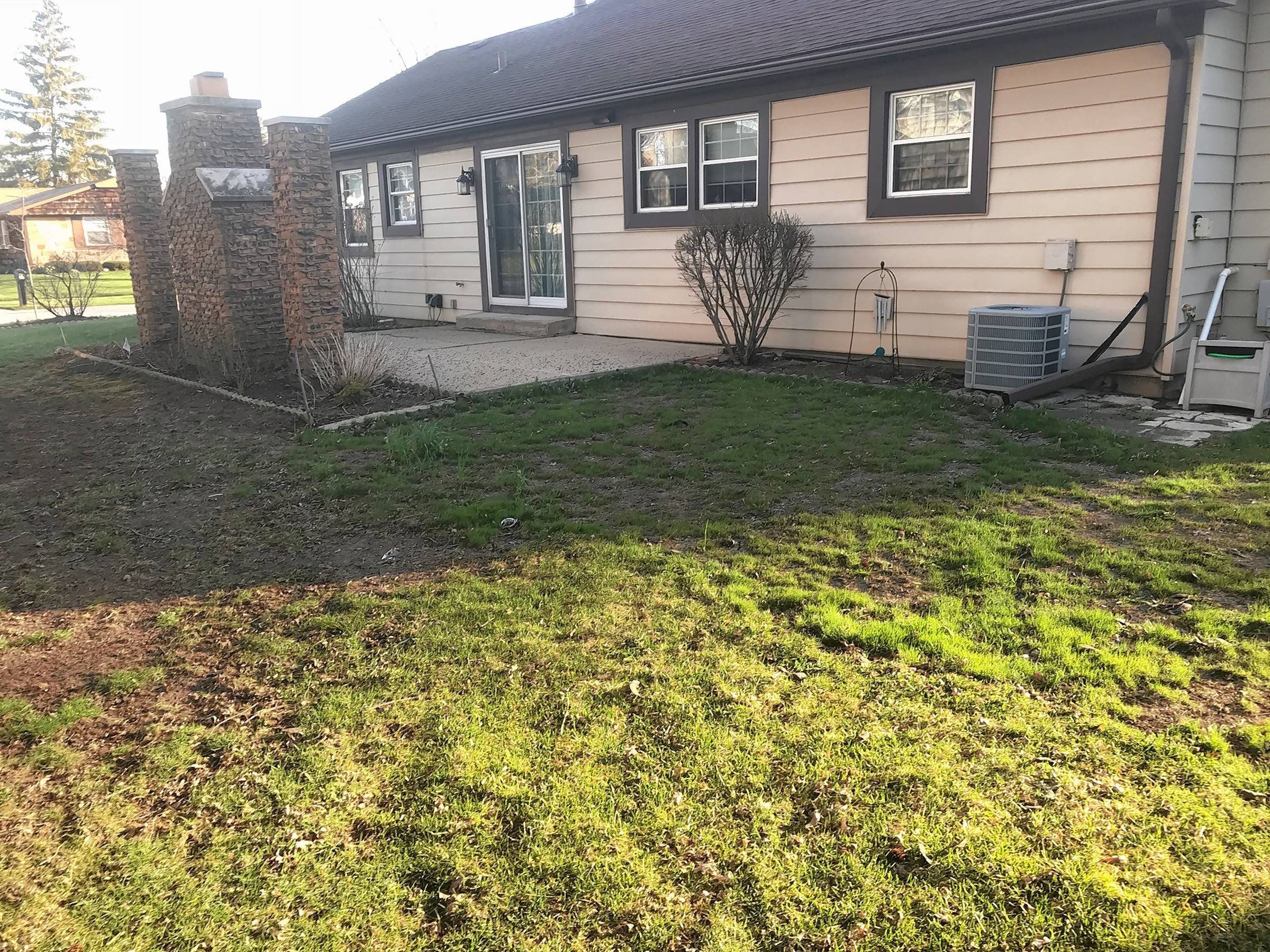 Roseann Portiera of Buffalo Grove says her backyard, starting with a broken pizza oven, is the ugliest one on her block.