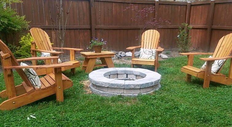 Adirondack chairs around fire pit.