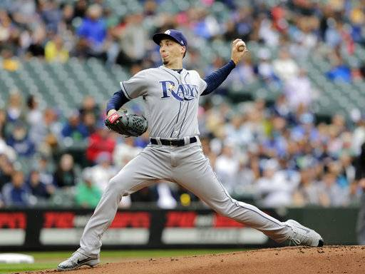 Tampa Bay Rays starting pitcher Blake Snell works against the Seattle Mariners during the first inning of a baseball game on Sunday, June 3, 2018, in Seattle.