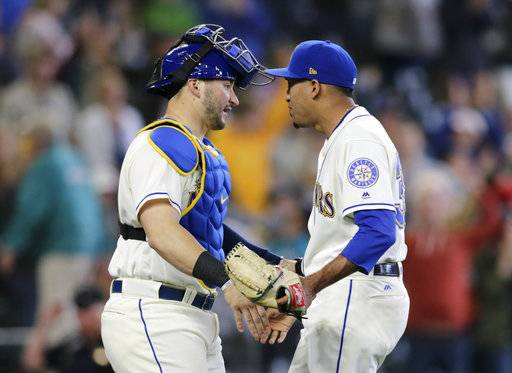 Seattle Mariners closing pitcher Edwin Diaz and catcher Mike Zunino greet each other after the 2-1 win over the Tampa Bay Rays in a baseball game on Sunday, June 3, 2018, in Seattle.