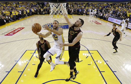 0491bb1c454 Golden State Warriors  Stephen Curry (30) drives to the basket as Cleveland  Cavaliers
