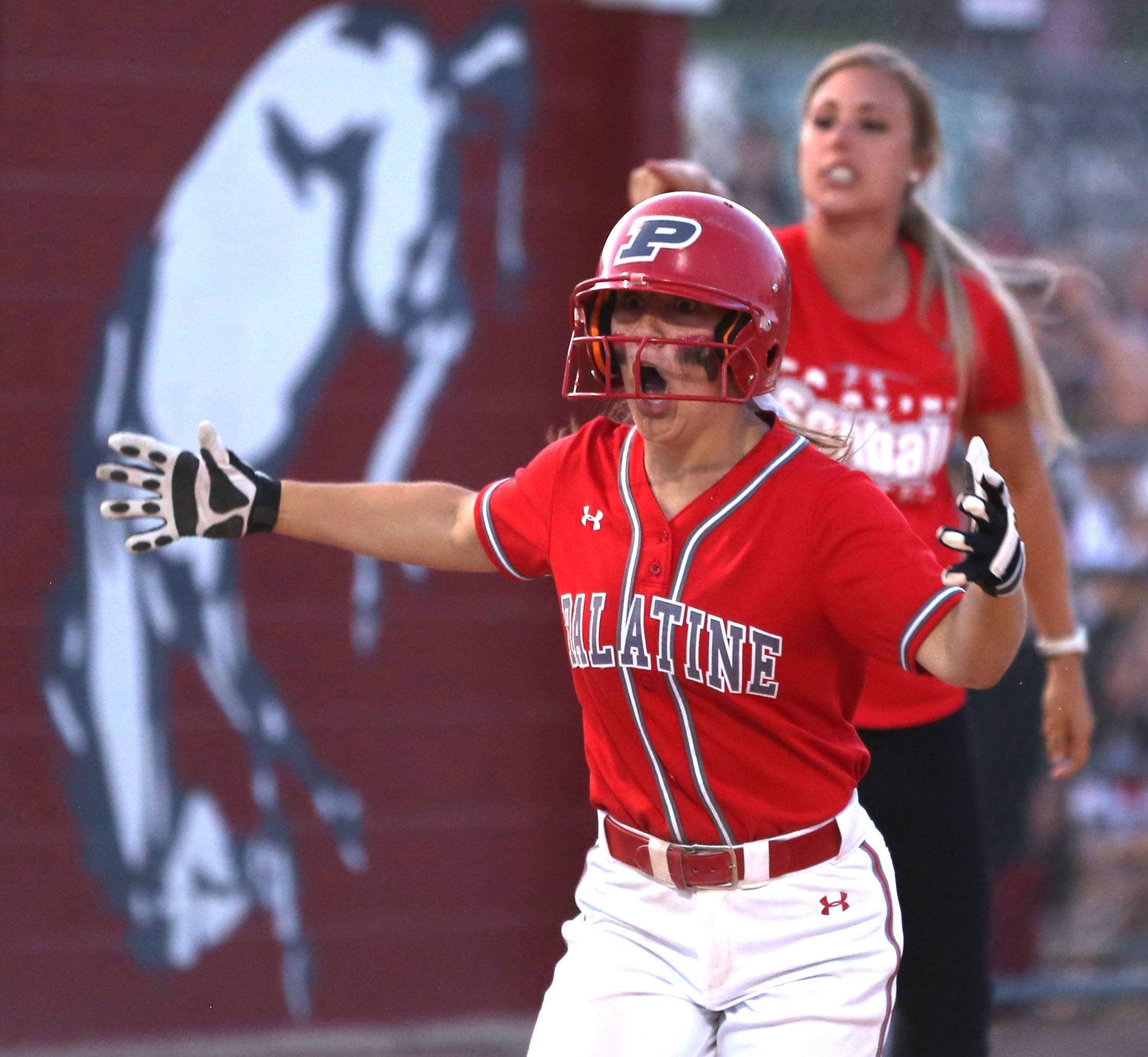 Palatine's Kaitlyn Reed heads for the plate after her home run during Class 4A supersectional action at Barrington on Monday night.